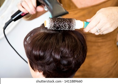 Mature woman at the hairdresser