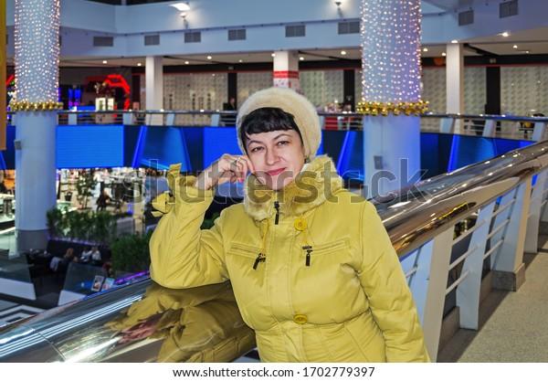 mature-woman-hall-shopping-entertainment