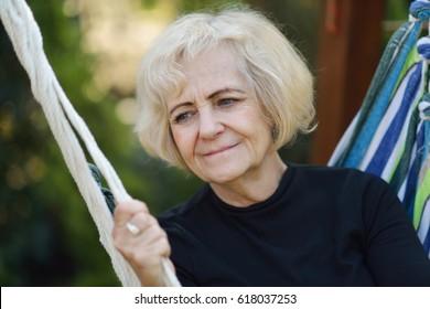 Mature woman in hammock.