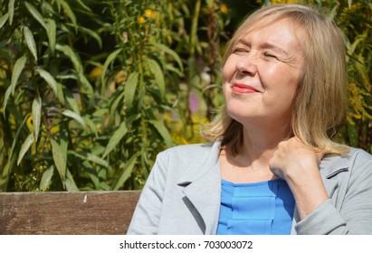 mature woman happy in the sun