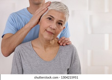 Mature Woman having chiropractic adjustment. Osteopathy, Physiotherapy, acupressure, holistic care