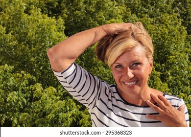 Mature Woman Having a Hot Flash - close up