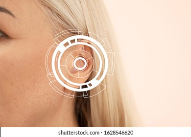 Mature woman with hearing problem on color background, closeup