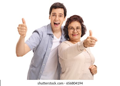 Mature woman with her grandson holding their thumbs up isolated on white background