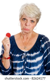 Mature woman with her last casino chip.