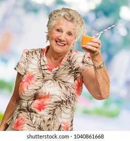 Mature Woman Holding Juice Glass, Outdoors