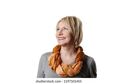 Mature woman looking happy smiles isolated on white background