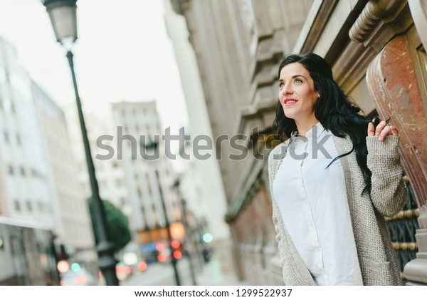 Mature woman looking towards the sky