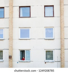 mature woman looking from window