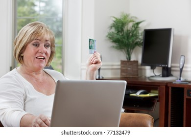 Mature woman looks happy as she shops online
