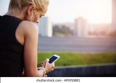 Mature woman outside using mobile phone