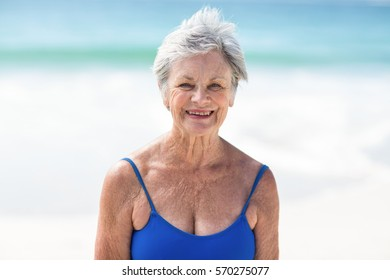 Mature woman posing in swimsuit at the beach