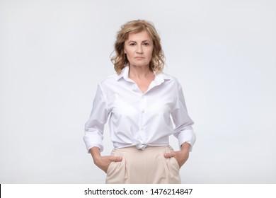 Mature woman with proud and arrogant emotion. Studio shot