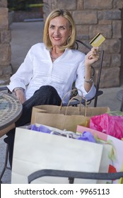 Mature woman resting after shopping