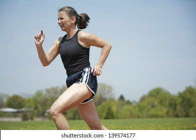 mature woman running outdoors in the park