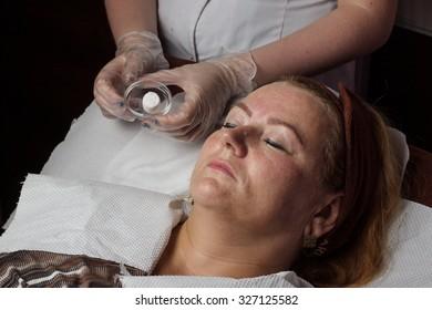 Mature woman in salon spa
