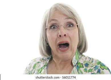 Mature woman scared and shocked isolated on white.