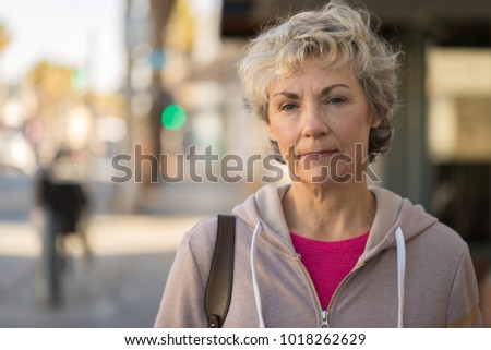 Mature woman serious face portrait