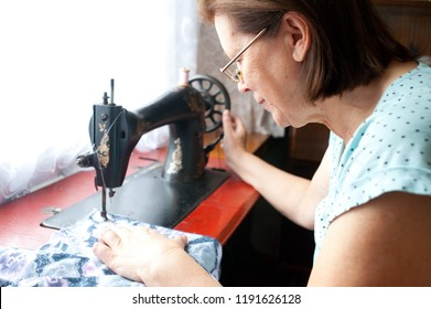 Mature woman sewing