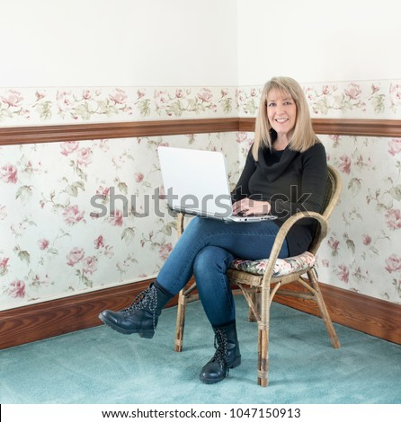 Mature blond on armchair
