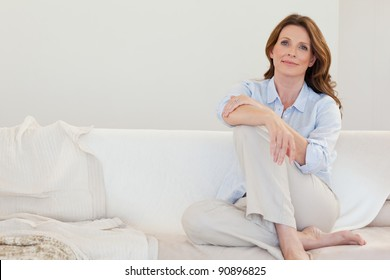 Mature woman sitting on her sofa