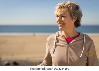 Mature woman smile happy face portrait near beach