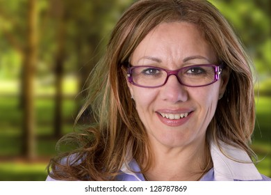 a mature woman is smiling in park
