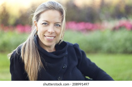 Mature Woman Smiling AT The Park