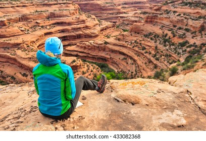 Mature woman studying map and terrain on a back country hike