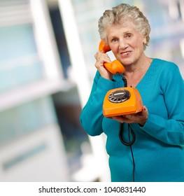 Mature Woman, Talking On Telephone, Indoor