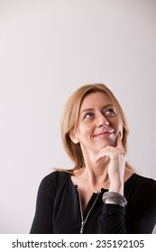 mature woman thinking about her great idea