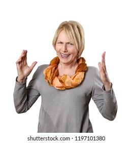 Mature woman throws hands disappointed isolated on white background