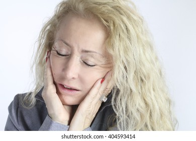 mature woman with a toothache