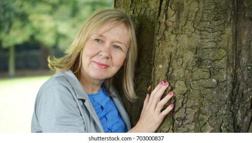 Mature Woman tree hugger