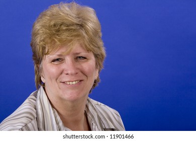 mature woman very happy on blue back ground