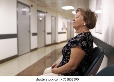 Mature woman waiting for appointment at doctor's office in the hospital