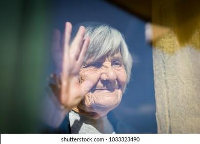 Mature woman waiting on window
