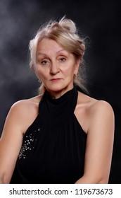 Mature woman wearing black dress