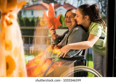 Mature woman in wheelchair with nurse