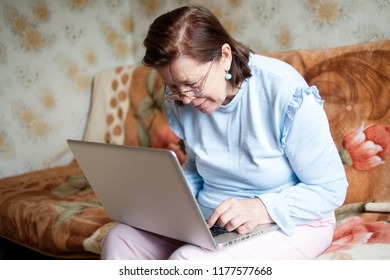 Mature woman working with computer