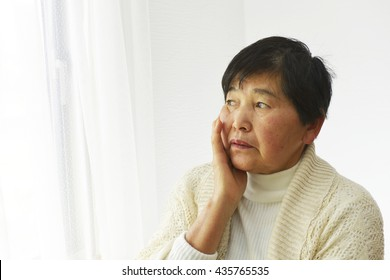 Mature woman worried about the future isolated