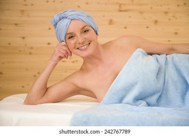 Mature womanan wrapped in a towel, portrait