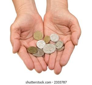 A mature woman's hands, palms open, holding money.