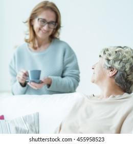 Mature women drinking coffee and reading book