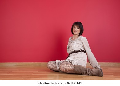 mature women sited in the floor of his new house