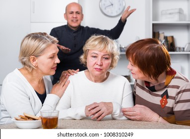 Mature women are warm solace their girlfriend who is quarreled with man at home.