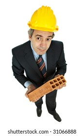 mature worker holding a brick, isolated on white