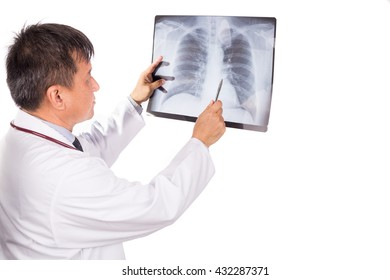 Matured Asian medical doctor examining lungs X-ray negative film on white background