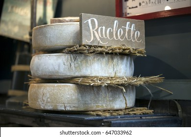 Maturing Raclette cheese with tag on the farmer market