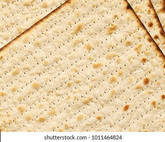 Matza texture close up, jewish traditional dry bread for Passover celebration. Matzah top view background,  Israel national Holiday food.